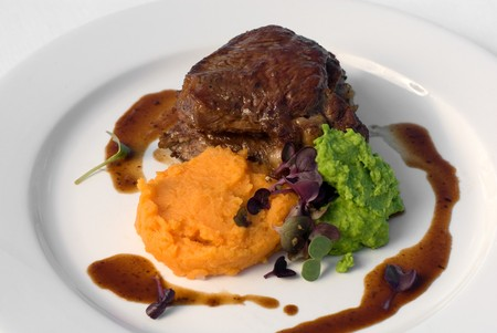 jus: Pasture-fed Sirloin Steak, with Sweet Potato Mash, Pea Puree, and a Red Wine Jus Stock Photo