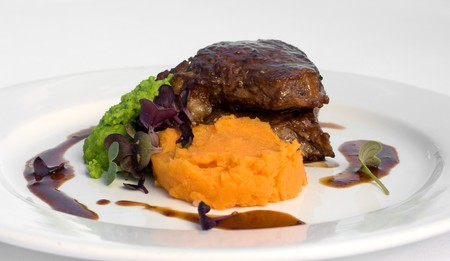 sirloin steak: Pasture-fed Sirloin Steak, with Sweet Potato Mash, Pea Puree, and a Red Wine Jus Stock Photo