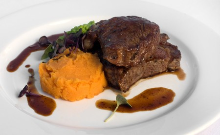 Pasture-fed Sirloin Steak, with Sweet Potato Mash, Pea Puree, and a Red Wine Jus Stock Photo