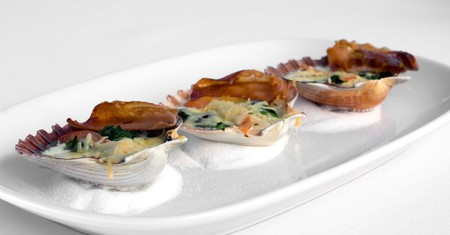 Tasmanian Scallops in the shell, grilled with Pancetta, Spinach, and a two-cheese sauce photo