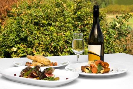 Three delicious luncheon dishes, complete with a bottle of quality Chardonnay Stock Photo - 7405759
