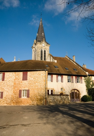 Houses and a church spire in a tiny village, France Stock Photo - 8999999