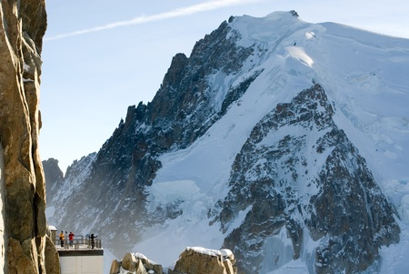 crevasse: Tourists at the closest point to Mont Blanc, France Stock Photo