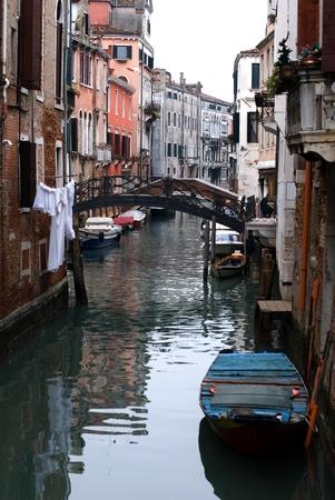 A footbridge over a canal, Venice, Italy photo