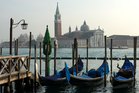 Gondolas moored on the Grand Canal, Venice, Italy photo