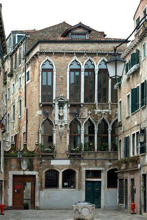 The rustic facade of an apartment building, Venice, Italy photo