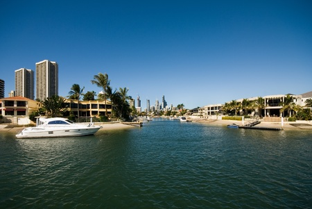A waterway scene, with luxury homes and apartment buildings, Surfers Paradise, Queensland, Australia photo