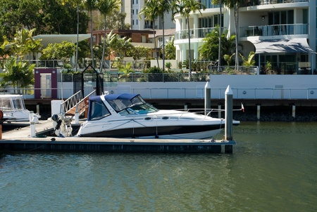 A boat moored beside a luxury home, Surfers Paradise, Queensland, Australia Stock Photo - 11025657
