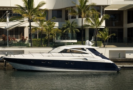A boat moored beside a luxury home, Surfers Paradise, Queensland, Australia Stock Photo - 11025656