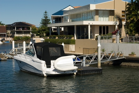 A boat moored beside a luxury home, Surfers Paradise, Queensland, Australia Stock Photo - 11025660