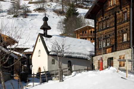 A village scene in the Swiss Alps Stock Photo - 12470295