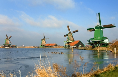 typically dutch: Traditional dutch windmills in the quaint village of Zaanse Schans, the Netherlands