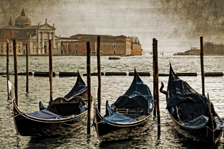Gondolas moored on the Grand Canal, Venice, Italy Stock Photo - 16990993