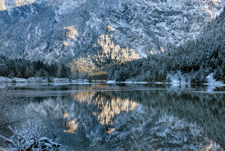 frozen lake: A picturesque winter reflection scene, in a partly frozen lake, Austria