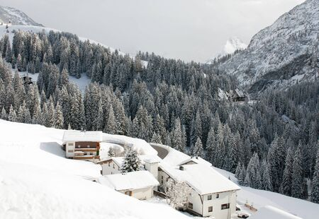 chalets: Chalets on the side of a mountain, near the village of Warth-Schrcken, in Austria Stock Photo