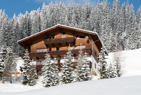 pine forest: A chalet on the side of a mountain, near the village of Warth-Schrcken, in Austria