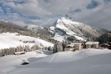 chalets: Chalets in the village of Warth-Schrcken, and Mount Biberkopf, Warth am Alberg,Vorarlberg, Austria