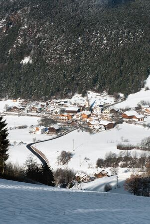 steeples: A small alpine village in an alpine region of Northern Italy