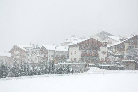 chalets: Chalets, during a snowstorm, in Mals, Northern Italy