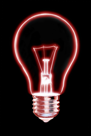 Outline of old tungsten lightbulb glowing red , on black background Stock Photo