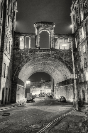 Black and white grainy image of Carlton Road Tunnel and Waterloo Place, Edinburgh City Centre, UK.