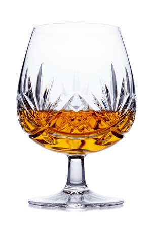 A single crystal brandy glass, shot on white, with a small reflection Stock Photo