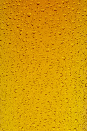 A close up of a glass of Lager, showing texture of the condensation