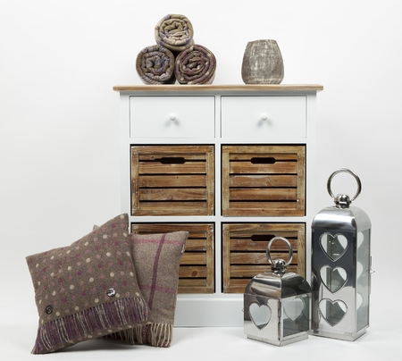 Chest of drawers, cushions, throws, ornaments and candle holders on a white background 版權商用圖片