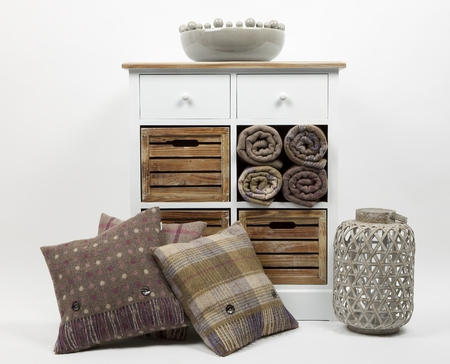 Chest of drawers, cushions, throws, ornaments and wicker candle holder on a white background 版權商用圖片