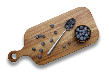 blueberries and silver spoon on a wooden chopping board on a white  background Zdjęcie Seryjne