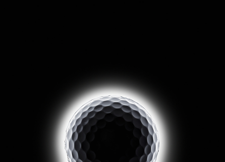 single golf ball with eclipse like effect on a black background