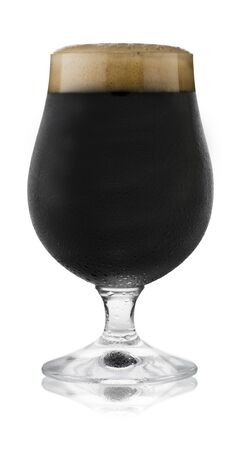 Isolated image of a refreshing glass of stout, in a schooner glass, with condensation