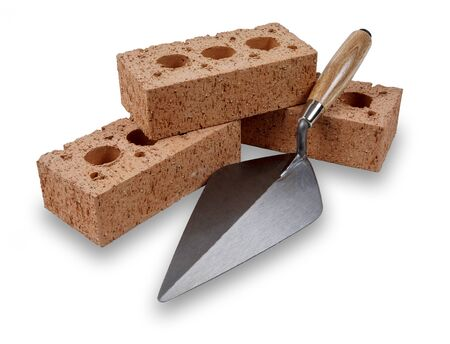 A set of house building bricks and trowel, isolated on a white background with a drop shadow