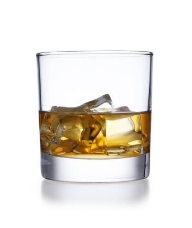 A isolated tumbler style glass of whisky and ice, shot on white with a slight reflection Stock Photo