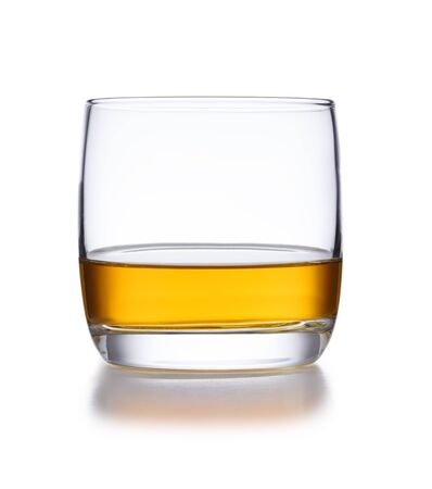 A isolated bowl style glass of whisky, shot on white with a slight reflection