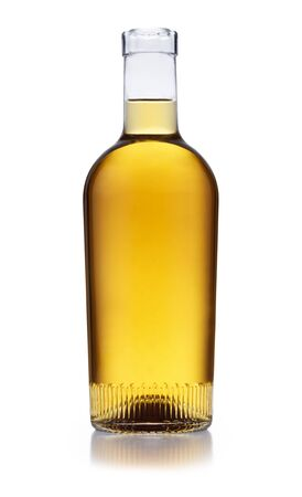 An ornate bottle full of golden whisky, with no label or branding, isolated on white with a slight reflection Foto de archivo