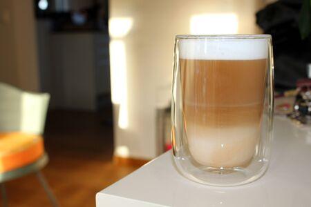 Latte macchiato glass on board