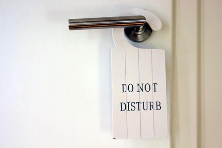 toilet  restroom door with do not disturb sign