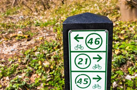 guidepost: Bicycle finger post showing the directions through the dunes in northern Holland. sign is showing the routes With Their numbers