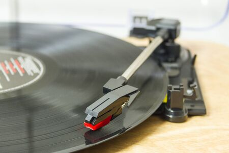 Record player playing vinyl record