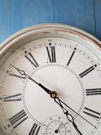 Wall clock against  a blue  back ground