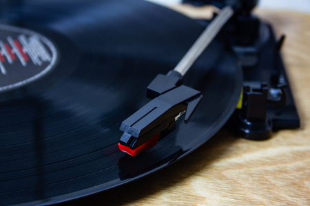 Vinyl is back in. a record player with the stylus on the record Фото со стока