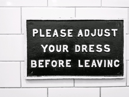 Please adjust your dress before leaving Фото со стока