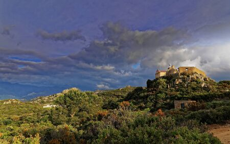 Low wide angle shot of Our Lady of Serra Calvi Corsica at sunset