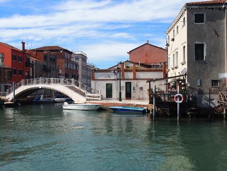 Boats and bridge in guidecca in Venice