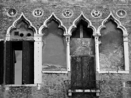 the merchant of venice: venice old building with ornate shuttered windows Stock Photo
