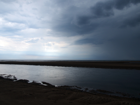 stromy weather with beach and sea in northumbria england