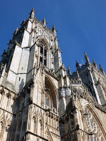 york minster with towers and blue sky