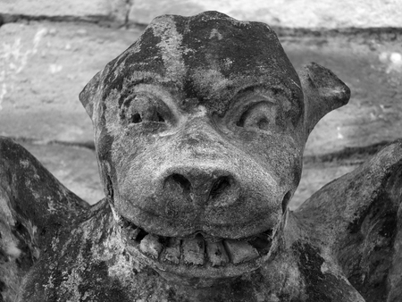 gargouille: medieval gargoyle fave on stone church wall in york