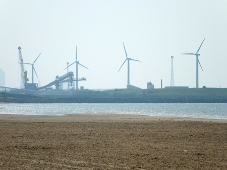 cosby beach near liverpool with industry and wind turbines Stock Photo
